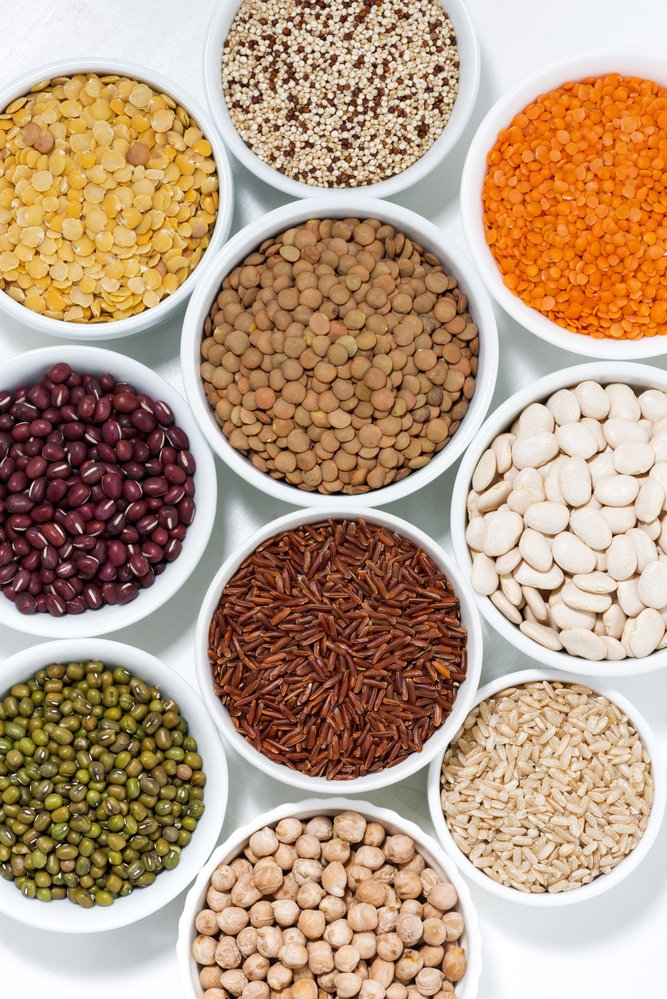 assortment of various legumes in bowls, top view